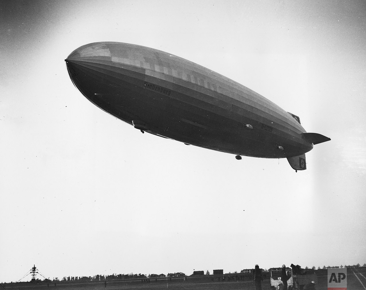 The German dirigible Hindenburg, with the swastika symbol visible on its tail wing, is shown just before it crashed upon landing at the U.S. Naval Station in Lakehurst, N.J., on May 6, 1937.  (AP Photo)