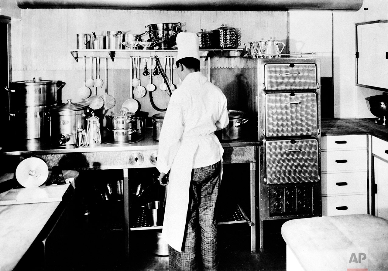 A modern, electrically equipped kitchen aboard the zeppelin Hindenburg provides for the passengers and crew, seen in this undated photograph. (AP Photo)