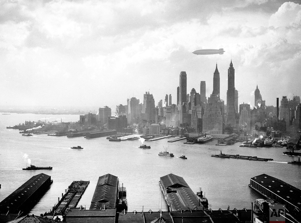 The German zeppelin Hindenburg floats over Manhattan Island in New York City on May 6, 1937.  (AP Photo)