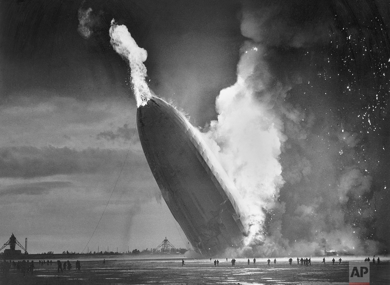 """In this May 6, 1937 photo, the German dirigible Hindenburg crashes to earth in flames after exploding at the U.S. Naval Station in Lakehurst, N.J. Only one person is left of the 62 passengers and crew who survived when the Hindenburg burst into flames 80 years ago Saturday, May 6, 2017. Werner Doehner was 8 years old when he boarded the zeppelin with his parents and older siblings after their vacation to Germany in 1937. The 88-year-old now living in Parachute, Colo., tells The Associated Press that the airship pitched as it tried to land in New Jersey and that """"suddenly the air was on fire."""" (AP Photo/Murray Becker)"""
