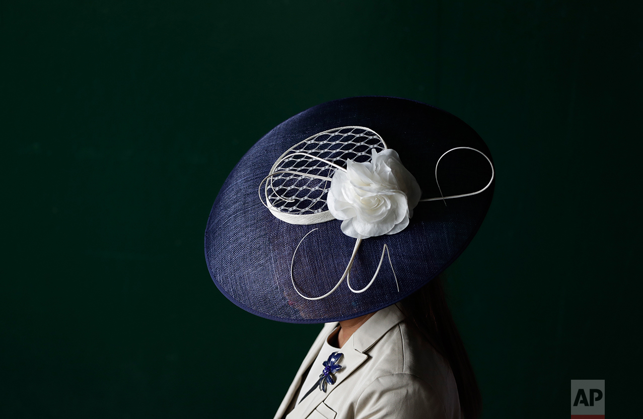 A woman wears a fancy hat before the 143rd running of the Kentucky Derby horse race at Churchill Downs Saturday, May 6, 2017, in Louisville, Ky. (AP Photo/Matt Slocum)