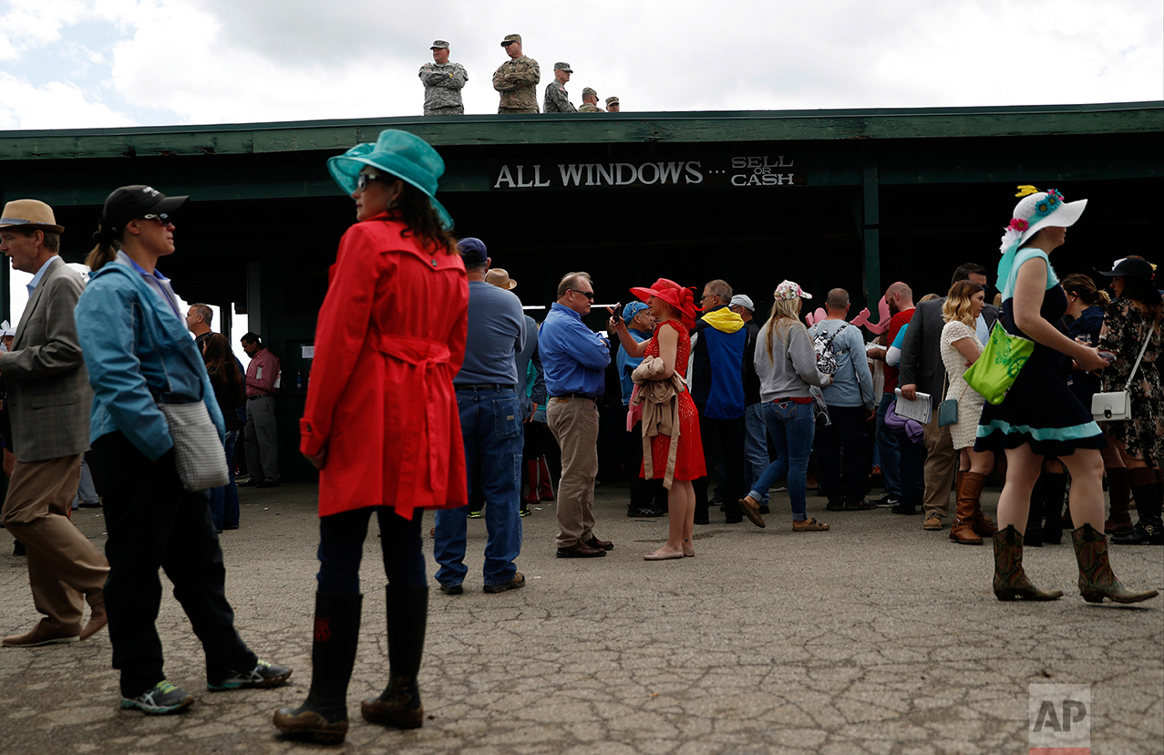 Military personnel look over a crowd before the 143rd running of the Kentucky Derby horse race at Churchill Downs Saturday, May 6, 2017, in Louisville, Ky. (AP Photo/John Minchillo)
