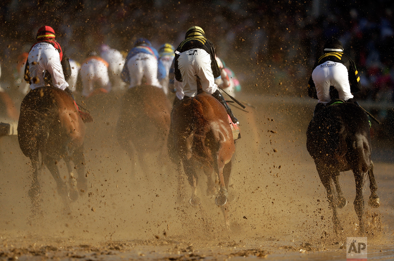 Horses run through the first turn during the 143rd running of the Kentucky Derby horse race at Churchill Downs Saturday, May 6, 2017, in Louisville, Ky. (AP Photo/Matt Slocum)