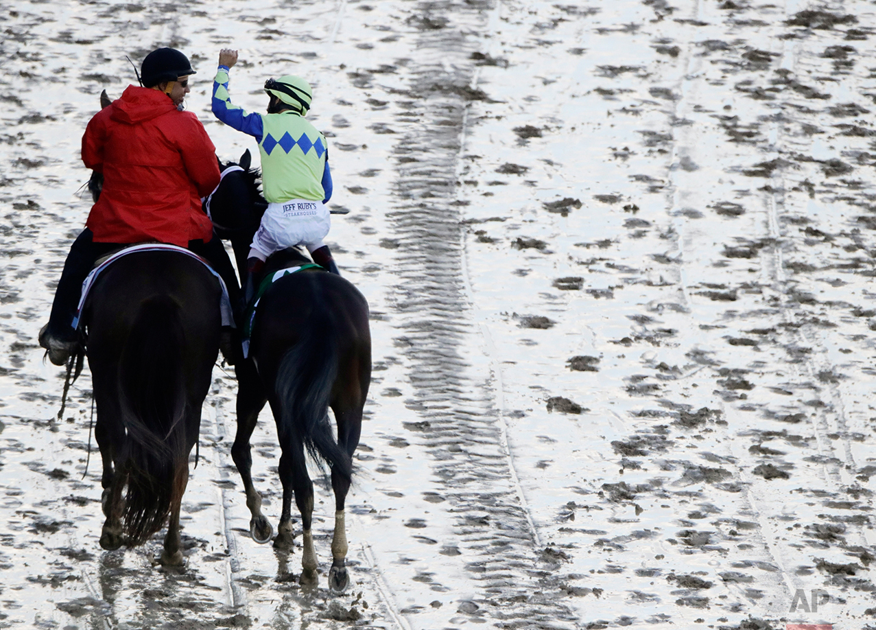 John Velazquez celebrates after riding Always Dreaming to victory in the 143rd running of the Kentucky Derby horse race at Churchill Downs Saturday, May 6, 2017, in Louisville, Ky. (AP Photo/Charlie Riedel)
