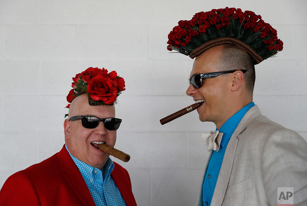 Fans smoke cigars before the 143rd running of the Kentucky Derby horse race at Churchill Downs Saturday, May 6, 2017, in Louisville, Ky. (AP Photo/John Minchillo)
