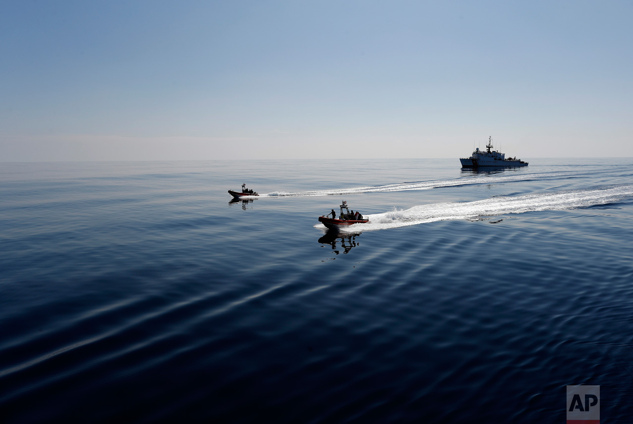 In this Feb. 26, 2017 photo, two U.S. Coast Guard fast boats carrying suspects detained in prior drug interdiction operations are transferred from the USCG cutter Mohawk, seen in the background, to the USCG cutter Stratton, in the eastern Pacific Ocean. To comply with international laws, a U.S. Coast Guard cutter must transfer all detainees to other ships in international waters before making a foreign port of call to re-supply. (AP Photo/Dario Lopez-Mills)