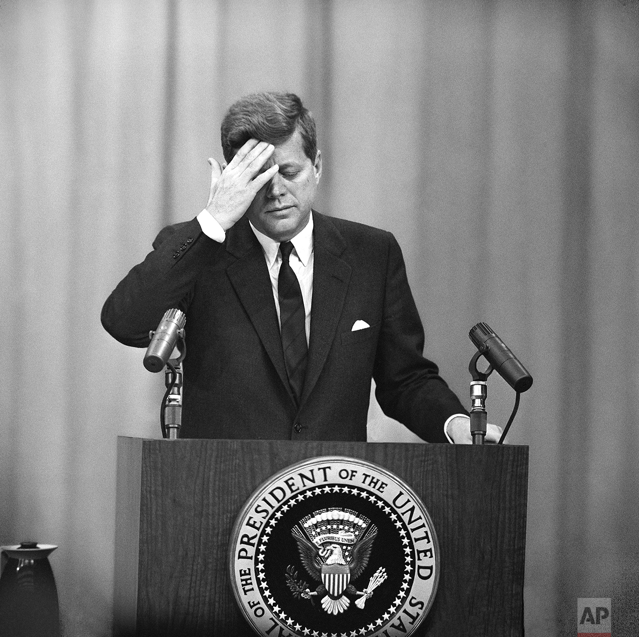 President John  Kennedy at a formal news conference in the new State Department auditorium on March 1, 1961 showed this expression as he answered questions from the press.     (AP Photo/Byron Rollins)