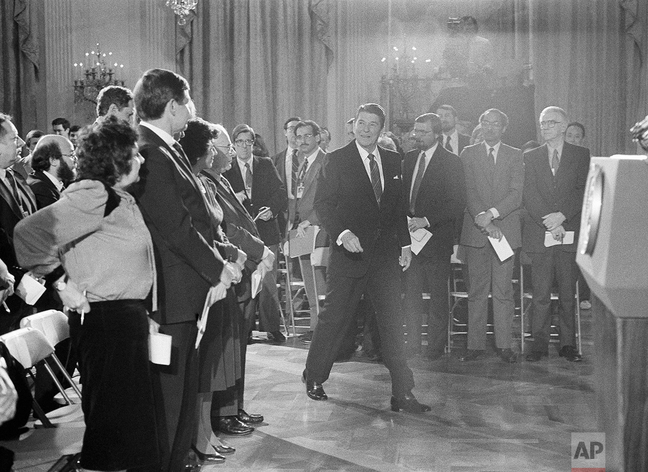 "President Ronald Reagan enters the White House East Room in Washington, Feb. 22, 1984 for a news conference, his first formal session with reporters since Dec. 20.  Reagan labeled as ""disgraceful, frankly,"" speculation that Secretary of State George Shultz might resign because of the failure of American attempts to work out a solution to the Lebanese crisis. (AP Photo/J. Scott Applewhite)"