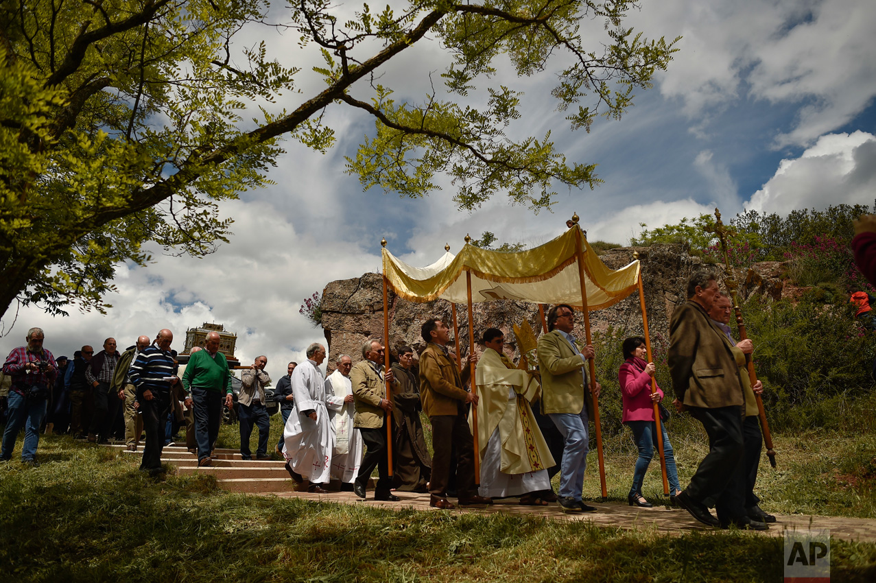 Devotes take part in the pilgrimage with the ancient relic of Saint Gregory in Sorlada, northern Spain, Sunday, May 14, 2017. Every year, devotes of the saint celebrate the blessing of the fields during the pilgrimage carrying the silver head of Saint Gregory, the saint known as Saint Protector of the Fields since the thirteenth century. (AP Photo/Alvaro Barrientos)