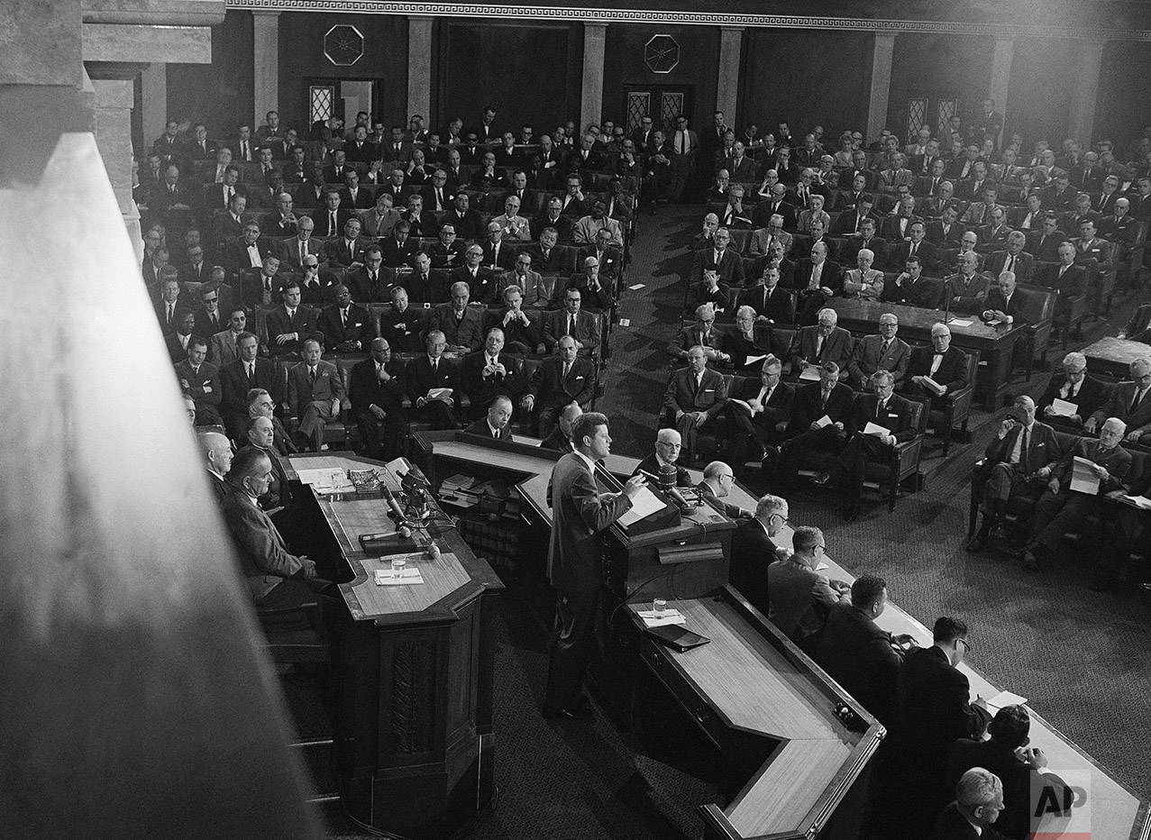 This is a partial view of the filled House of Representatives as President John F. Kennedy addresses a joint session of Congress, May 25, 1961 in Washington. Members of the diplomatic corps occupy the seats at left.  At lower left, rear of Kennedy, are House Speaker Sam Rayburn and Vice President Lyndon Johnson. (AP Photo)