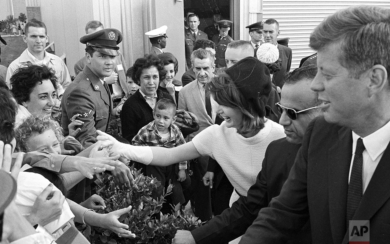 Eager hands reach out to shake hands with President John F. Kennedy and first lady Jacqueline Kennedy as they visited San Antonio, Tex., where the president dedicated the Aerospace Medical Center at Brooks Air Force Base, Nov. 21, 1963. (AP Photo/Ted Powers)