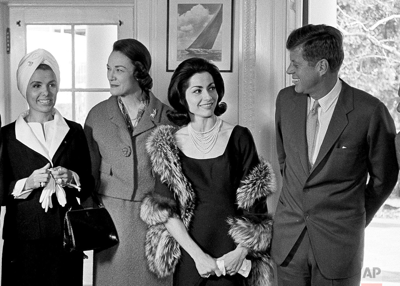 President John F. Kennedy poses at the White House with Democratic party big-wigs and entertainers who will participate in a January fundraising event for the party, Nov. 20, 1963, in Washington. From left: singer Lena Horne; Margaret Price, vice chairwoman of the Democratic National Committee; Broadway actress Carol Lawrence; Kennedy, and Sidney Salomon Jr. of St. Louis, chairman of the Third Inaugural Anniversary Salute. Men at far left and woman at far right are unidentified. (AP Photo/Harvey Georges)
