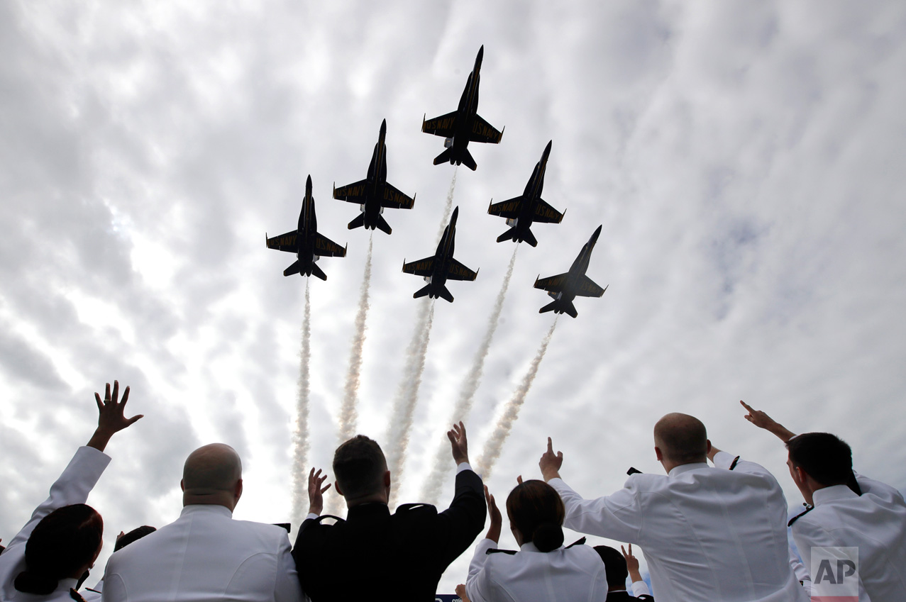 U.S. Navy Blue Angels fighter jets perform a flyover above graduating U.S. Naval Academy midshipmen during the Academy's graduation and commissioning ceremony in Annapolis, Md., Friday, May 26, 2017. (AP Photo/Patrick Semansky)