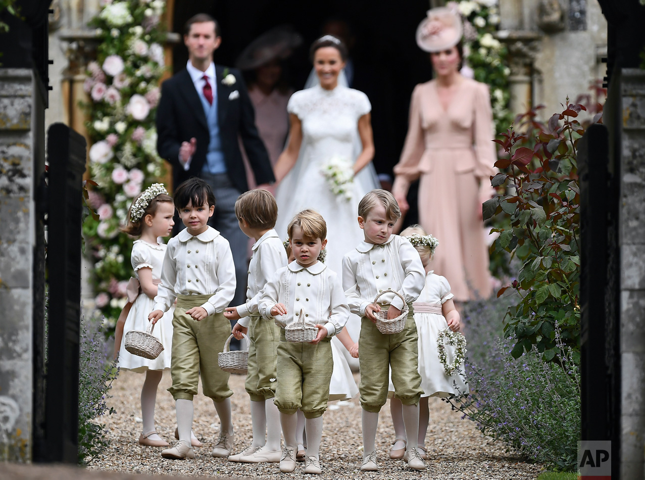 Britain's Prince George, foreground center, reacts after the wedding of his aunt, Pippa Middleton to James Matthews, at St Mark's Church in Englefield, England on Saturday, May 20, 2017. Middleton, the sister of Kate, Duchess of Cambridge, married hedge fund manager James Matthews in a ceremony Saturday where her niece and nephew Prince George and Princess Charlotte was in the wedding party, along with sister Kate and princes Harry and William. (Justin Tallis/Pool Photo via AP)