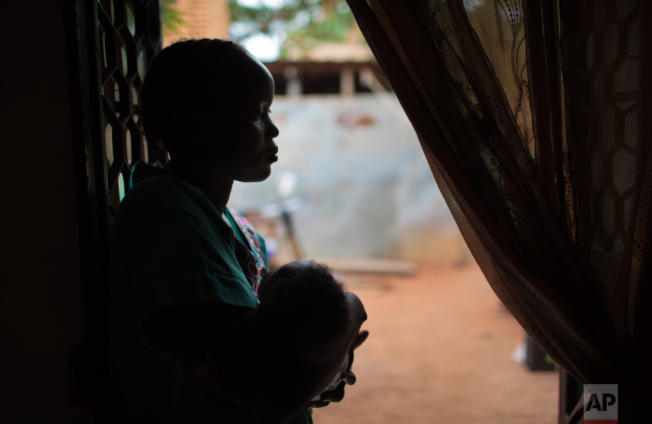 In this photo taken Saturday, May 13, 2017, Evelyn Juma, who says her husband Maurice was shot in the head by government soldiers, cradles her one-month-old daughter Mauricia in Wau, South Sudan. South Sudan's civil war, now into its fourth year, has killed more than 50,000 people and plunged parts of the nation into famine, while brutal accounts of government soldiers killing civilians based on their tribe are driving the country deeper into despair. (AP Photo)