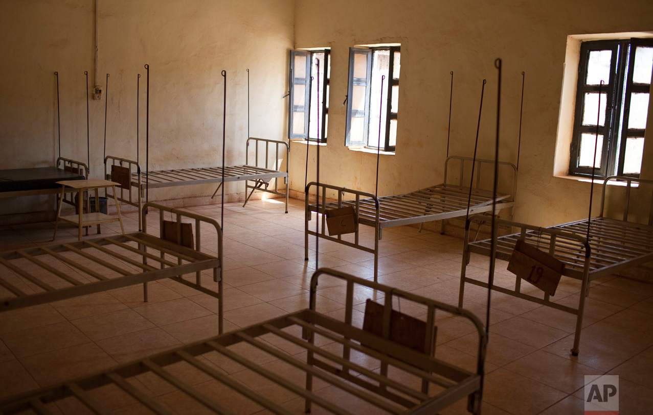 In this photo taken Friday, May 12, 2017, rows of empty beds line in a hospital after people who were terrified of attacks left the town to live in a United Nations' protected camp in Wau, South Sudan.(AP Photo)