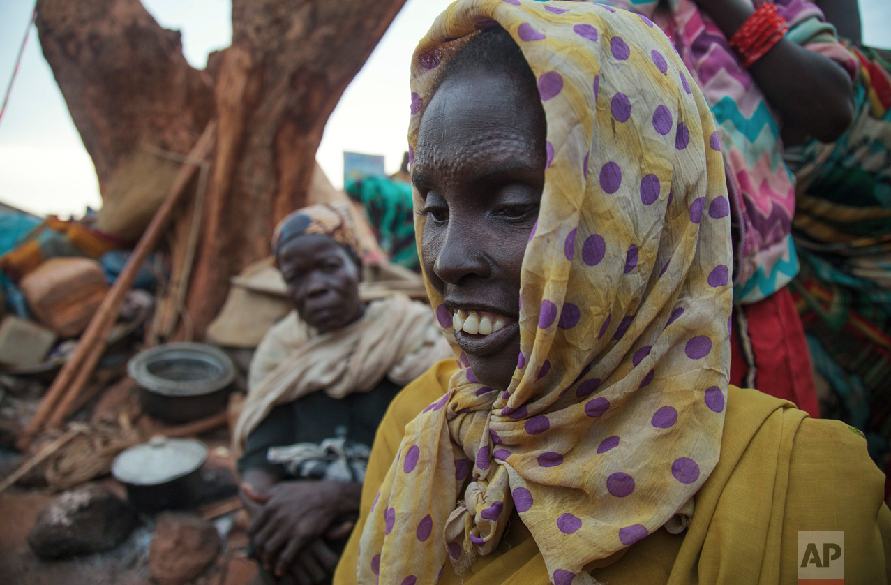In this photo taken Sunday, May 14, 2017, Rebecca Nyaden, who walked for seven days to flee her home in Aweil because of food scarcity caused by the drought, stands in the United Nations' protected camp in Wau, South Sudan, which since clashes in April is now the most congested internally displaced camp in the country, with almost 40,000 inhabitants. (AP Photo)