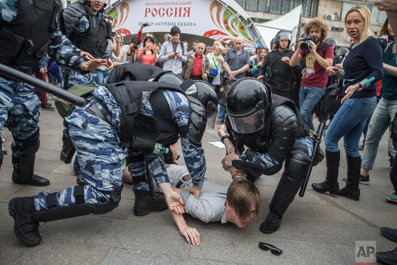 Police detain a protester In Moscow, Russia, on Monday, June 12, 2017. Demonstrators in Monday's opposition protests across Russia say they are fed up with endemic corruption among officials. The protest gatherings in cities from Far East Pacific ports to St. Petersburg were spearheaded by Alexei Navalny, the anti-corruption campaigner who has become the Kremlin's most visible opponent. (Evgeny Feldman/Pool Photo via AP)