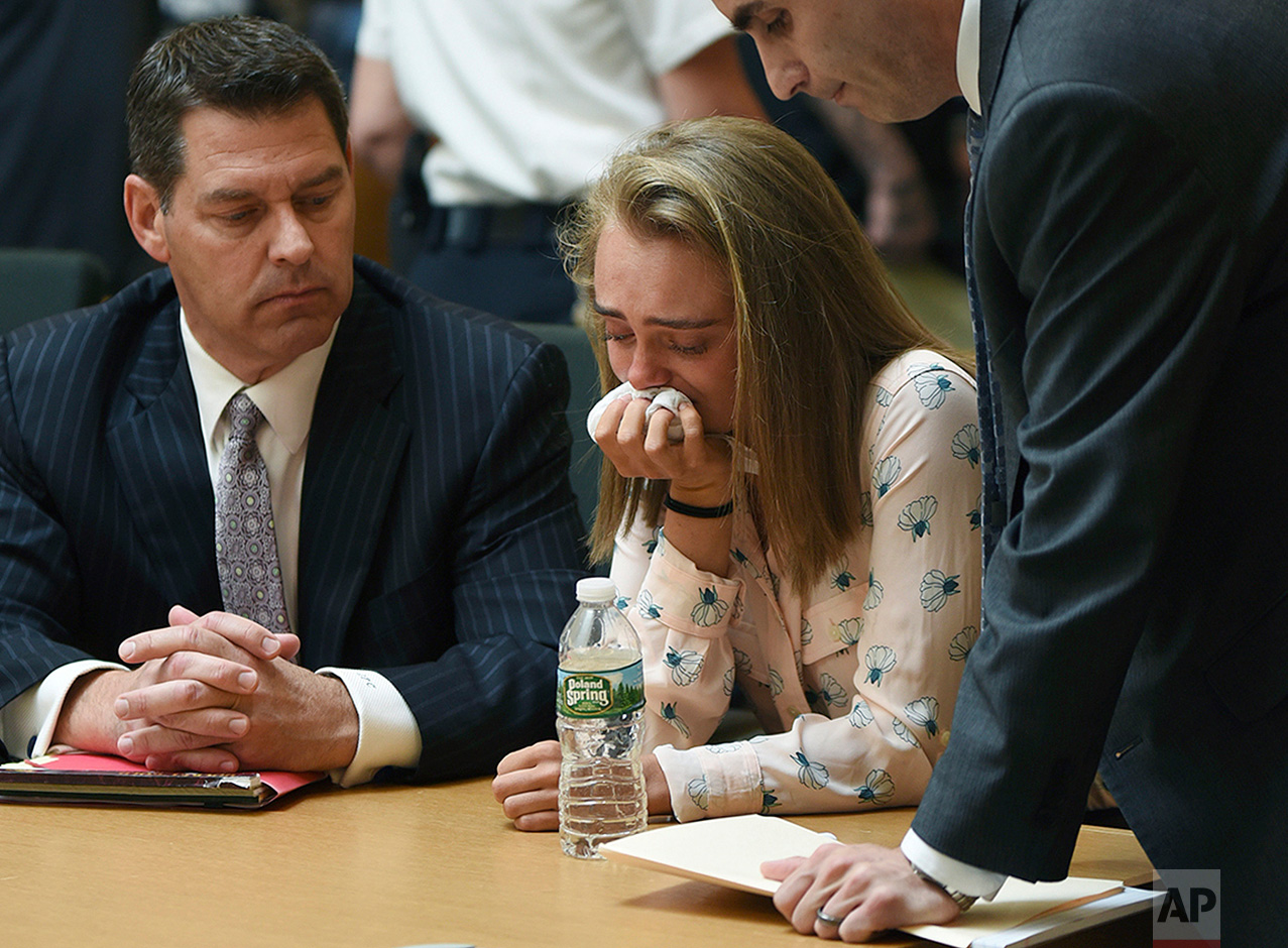 Michelle Carter cries while flanked by defense attorneys Joseph Cataldo, left, and Cory Madera, after being found guilty of involuntary manslaughter in the suicide of Conrad Roy III, Friday, June 16, 2017, in Bristol Juvenile Court in Taunton, Mass. The trial of Carter, who sent her boyfriend, Roy, a barrage of text messages urging him to kill himself when they were both teenagers, raised questions about whether words can kill. (Glenn C.Silva/Fairhaven Neighborhood News, Pool)