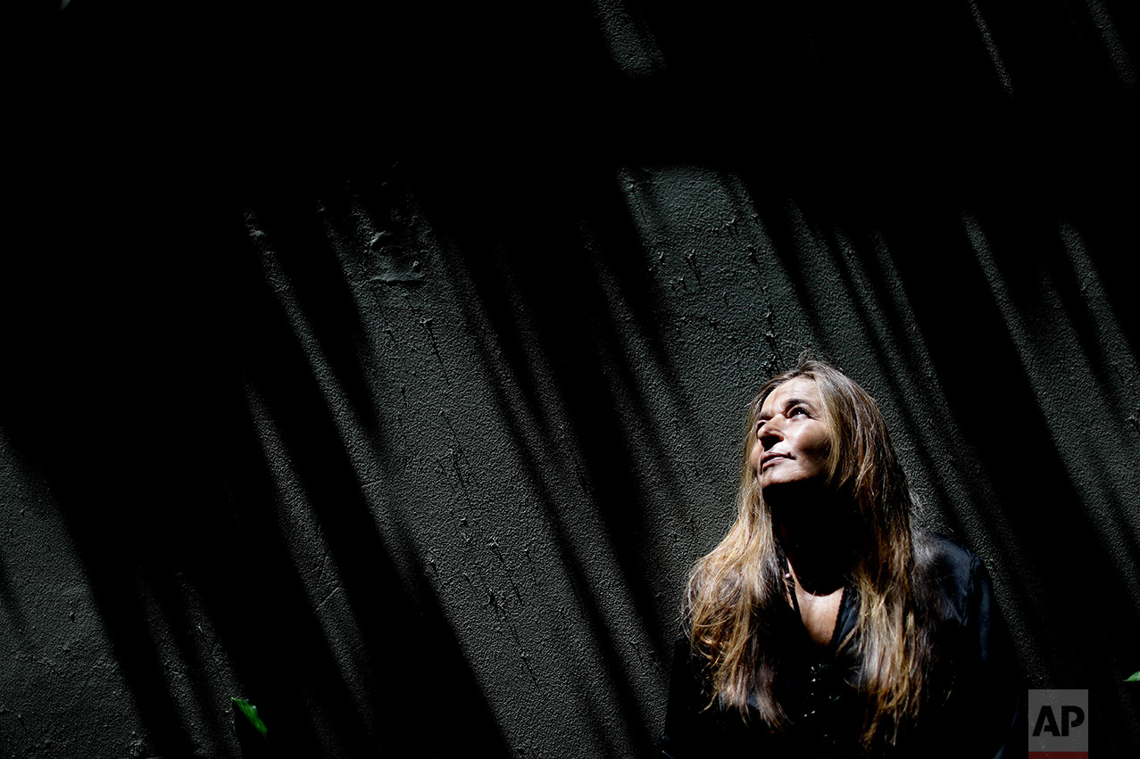 "In this Feb. 7, 2017 photo, Corina Fernandez poses for a portrait in Buenos Aires, Argentina. On Aug. 2, 2010, Fernandez was shot by her ex-husband three times in the chest at point blank range as she dropped her daughters off at school. She had reported to police death threats from her husband more than 80 times before she was finally shot, and the case set a legal precedent for gender violence in Argentina. Her husband died in prison on 2014. ""I did not feel happy nor angry, but relieved,"" said Fernandez. (AP Photo/Natacha Pisarenko)"