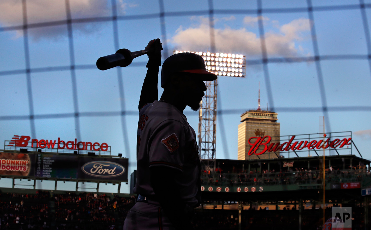 In this Wednesday, May 3, 2017 photo, Baltimore Orioles' Adam Jones prepares to bat prior to the first inning of a baseball game against the Boston Red Sox at Fenway Park in Boston. The teams play the final game of their series, one filled with player ejections and fan controversies, at Fenway Park on Thursday evening. (AP Photo/Charles Krupa)