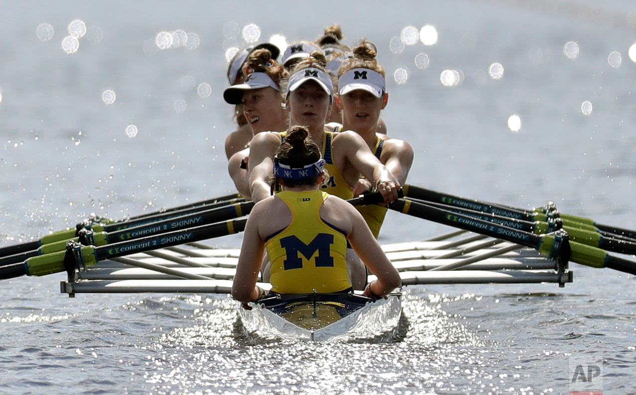 The Michigan women's varsity eight team compete during a semifinal race at the NCAA women's college rowing championships, Saturday, May 27, 2017, at Mercer County Park in West Windsor, N.J. (AP Photo/Julio Cortez)