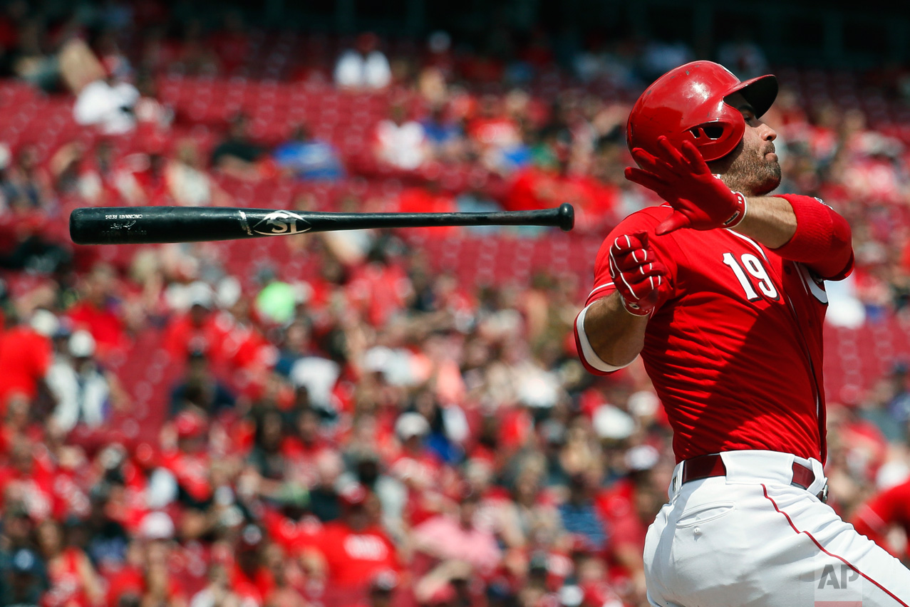 Cincinnati Reds' Joey Votto loses his bat on a swing in the sixth inning of a baseball game against the Colorado Rockies, Sunday, May 21, 2017, in Cincinnati. (AP Photo/John Minchillo)