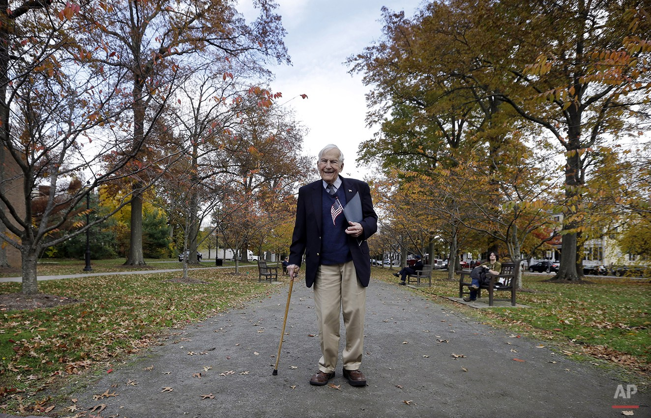 A U.S. Navy veteran of World War II and the Korean War, Ted Peters, of Cooperstown, N.Y., pauses as he walks from a Veterans Day ceremony in Princeton, N.J., Tuesday, Nov.11, 2014. (AP Photo/Mel Evans)