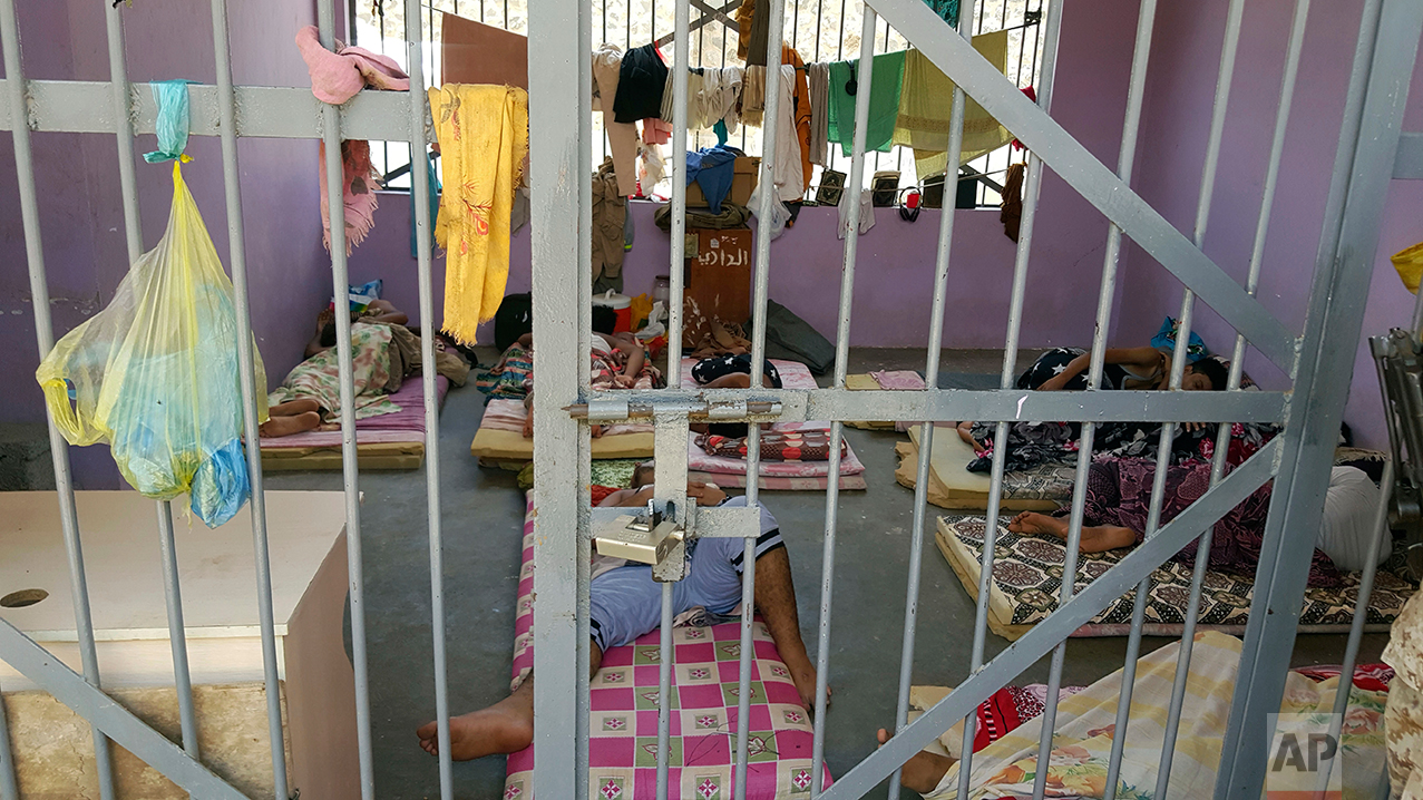 Prisoners lie in a newly renovated cell in Aden Central Prison.