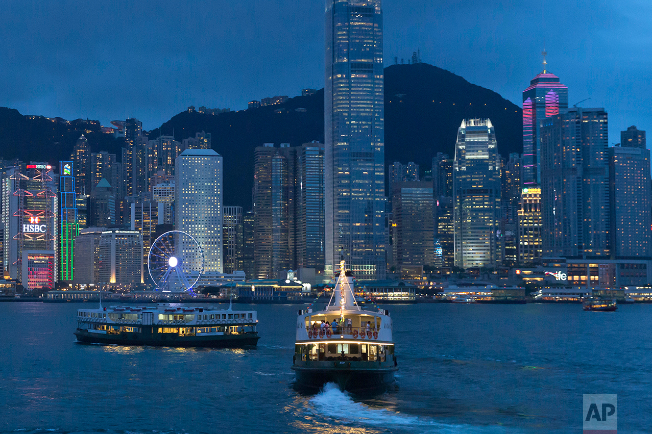 This June 20, 2017, photo, shows a general view of Victoria Peak and Central district over Victoria Harbor, in Hong Kong. (AP Photo/Kin Cheung)
