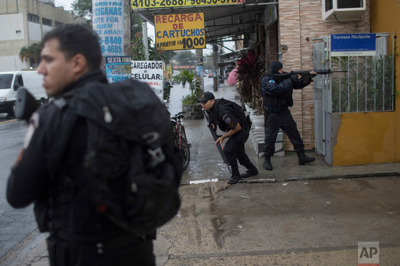 In this June 21, 2017 photo, police fight drug traffickers in the City of God slum in Rio de Janeiro, Brazil. (AP Photo/Leo Correa)