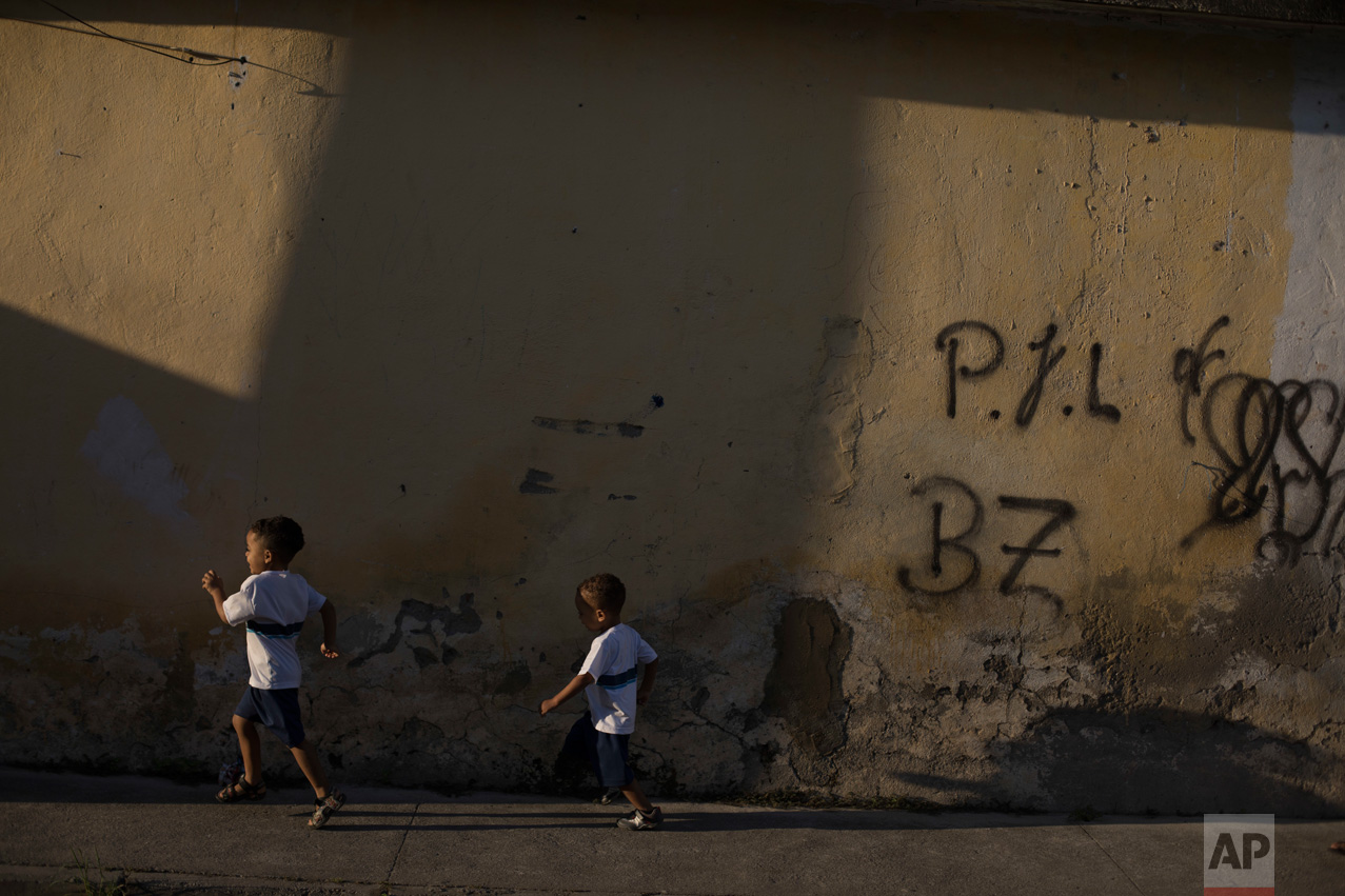 In this June 7, 2017 photo, children walk to school in the City of God slum of Rio de Janeiro, Brazil. (AP Photo/Leo Correa)