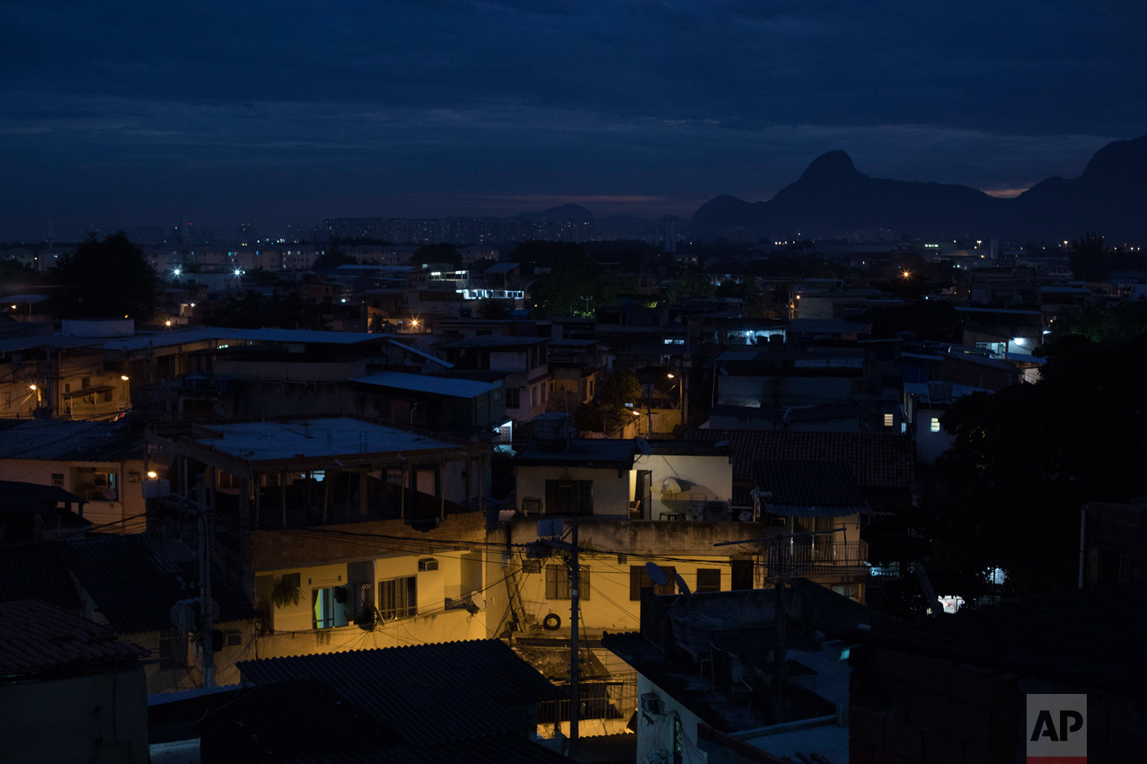 In this June 6, 2017 photo, homes stand at dusk in the City of God, one of Rio de Janeiro's most notorious and violent slums in Brazil. (AP Photo/Leo Correa)