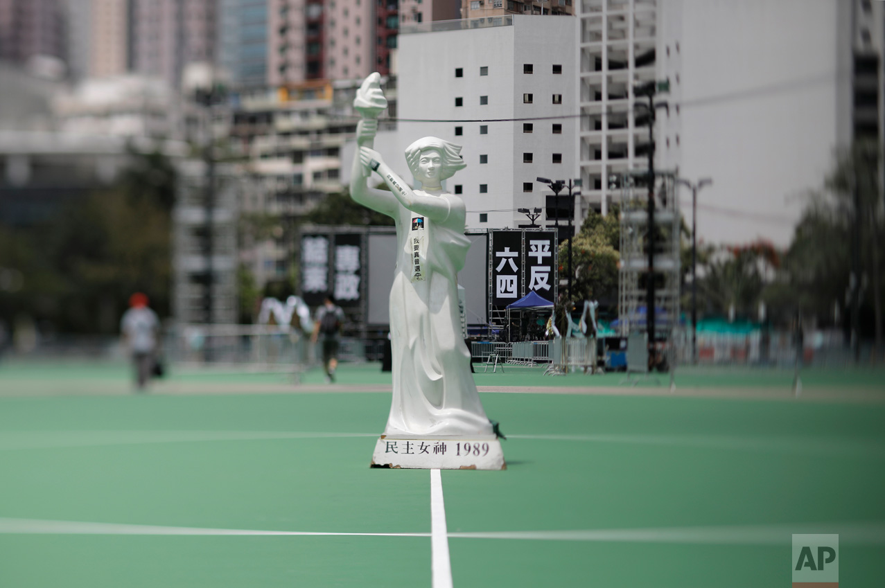 In this June 4, 2017, photo made with a tilt-shift lens, a statue of the Goddess of Democracy is displayed at Hong Kong's Victoria Park ahead of a candlelight vigil for victims of the Chinese government's military crackdown nearly three decades ago on protesters in Beijing's Tiananmen Square.(AP Photo/Vincent Yu)