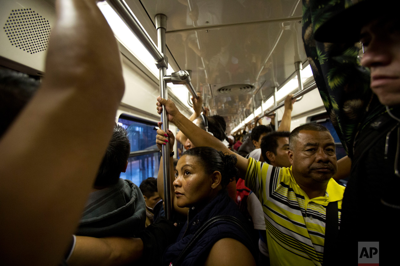 In this June 27, 2017 photo, Honduran refugee Laura Maria Cruz Martinez rides the subway during a 75-minute commute home following her 10-hour work day, in Mexico City. (AP Photo/Rebecca Blackwell)