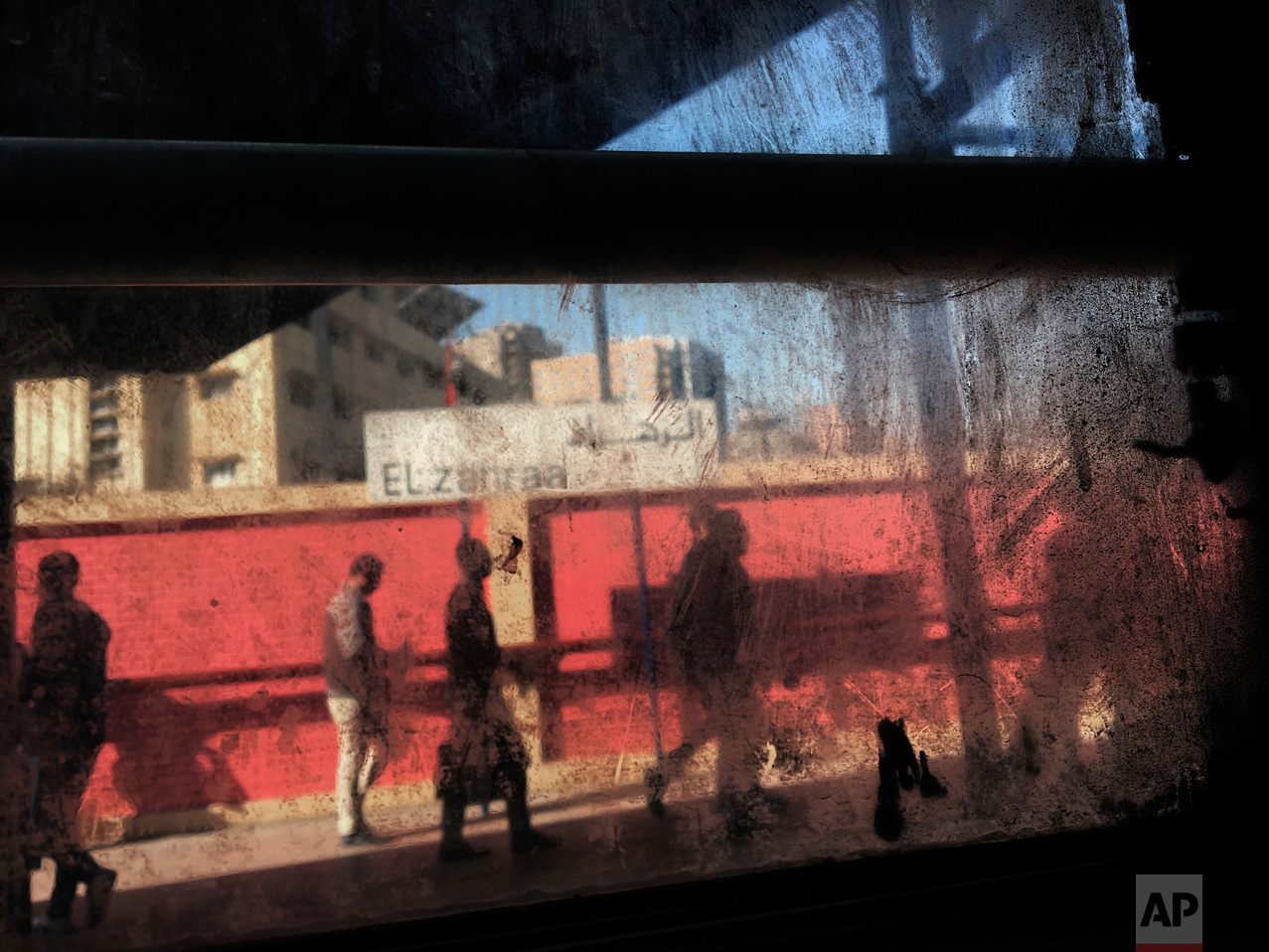 In this March 13, 2017 photo, people are seen from the window of a metro car, at El Zahraa metro station in Cairo, Egypt. (AP Photo/Nariman El-Mofty)