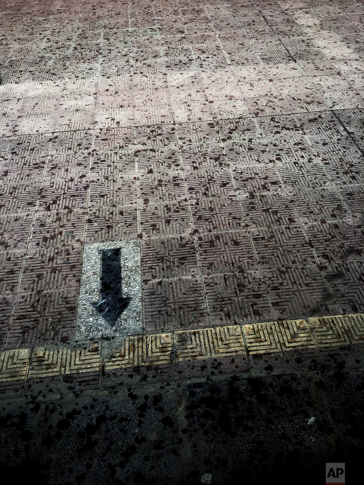 This May 18, 2017 photo, shows rain drops on the platform of a metro station, in Cairo, Egypt. (AP Photo/Nariman El-Mofty)