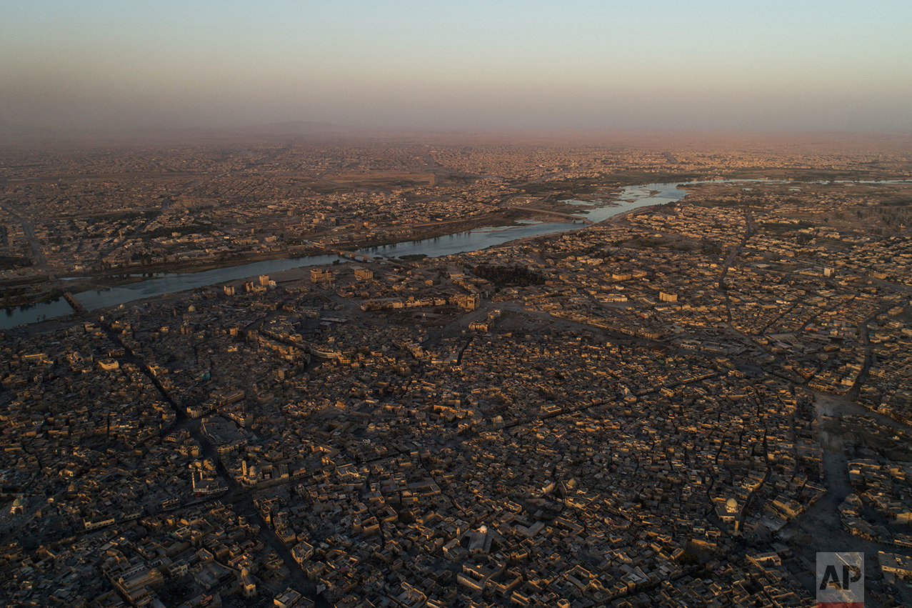 The Tigris river separates the east, top, and west side of Mosul during fighting between Iraqi security forces and Islamic State militants in Mosul, Iraq, Thursday, June 29, 2017. (AP Photo/Felipe Dana)
