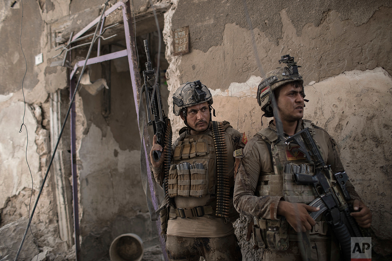 Iraqi Special Forces soldiers gather before advancing against Islamic State militants in the Old City of Mosul, Iraq, Sunday, July 2, 2017. (AP Photo/Felipe Dana)