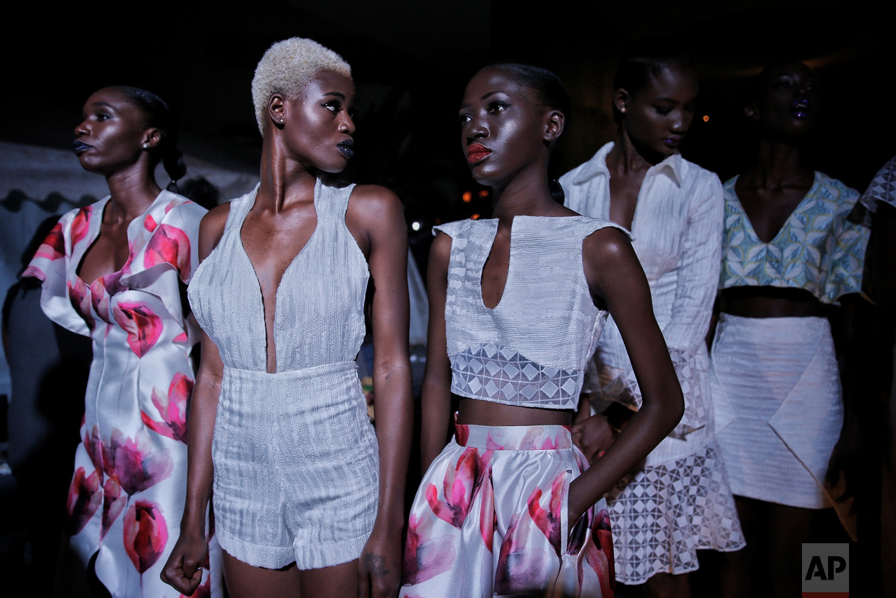 Models sit backstage during Dakar Fashion Week in the Senegalese capital, Friday June 30, 2017. (AP Photo/Finbarr O'Reilly)