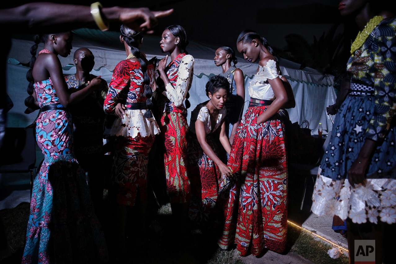 Models wait backstage during Dakar Fashion Week in the Senegalese capital, Saturday July 1, 2017. (AP Photo/Finbarr O'Reilly)