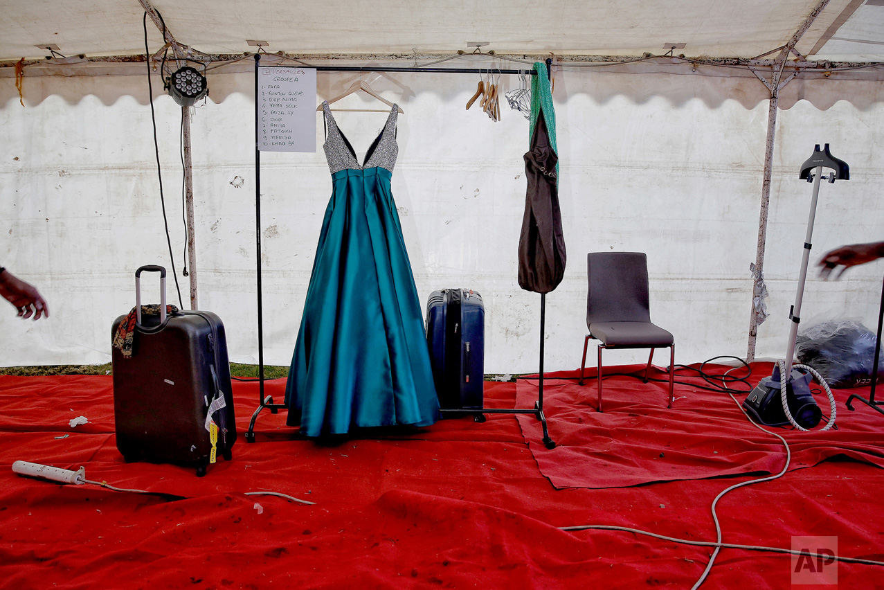 A dress hands on a clothes rack at the end of Dakar Fashion Week in the Senegalese capital, Friday July 1, 2017. (AP Photo/Finbarr O'Reilly)