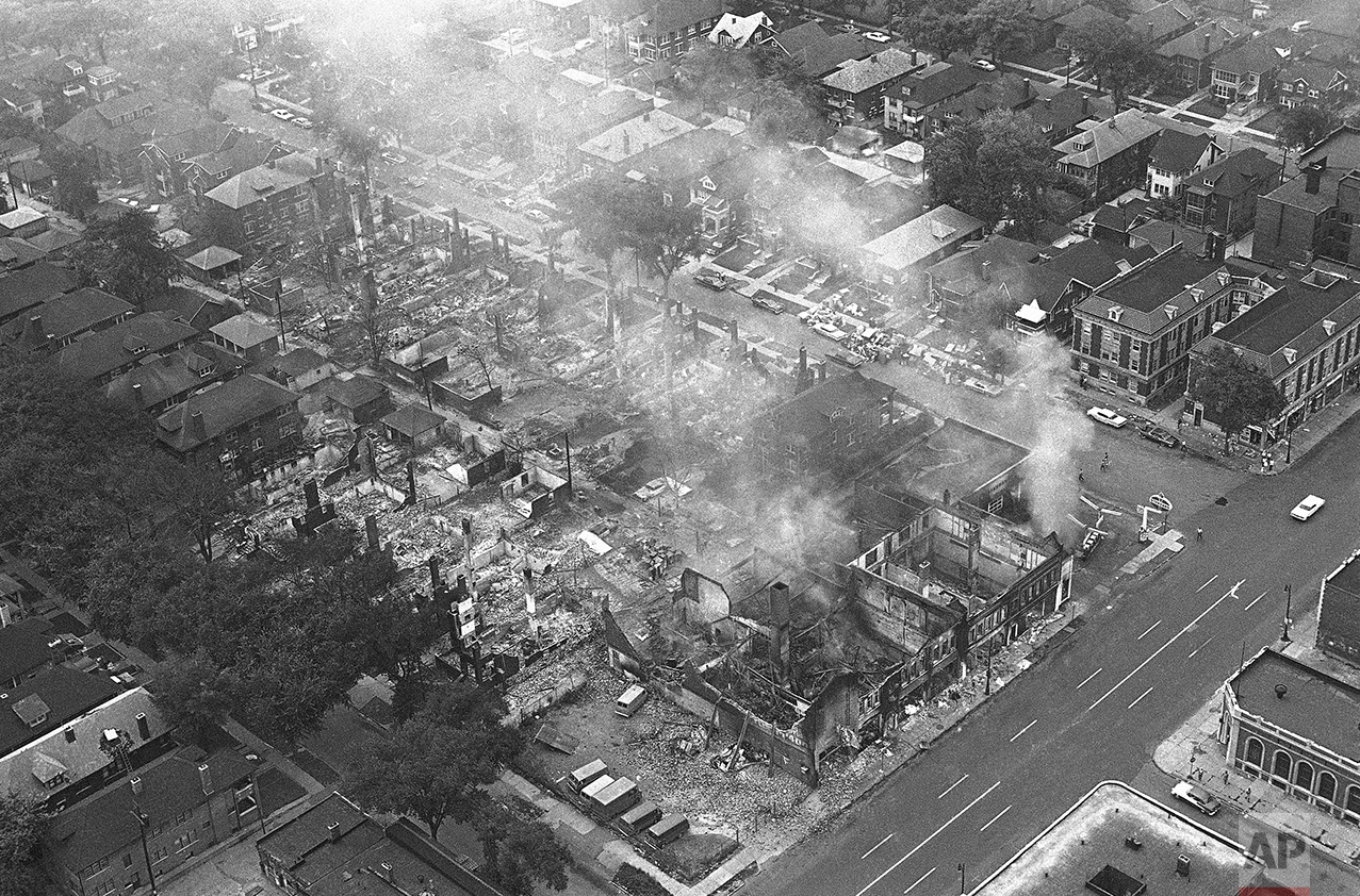 Entire block of buildings was destroyed by fire in Detroit, July 24, 1967 after rioters firebombed the filling station, right, and the fire spread to other buildings. Rampaging blacks hampered firemen called to fight the blaze. Intersection is Linwood, right, and Pingree on Detroit's near West Side. (AP Photo)