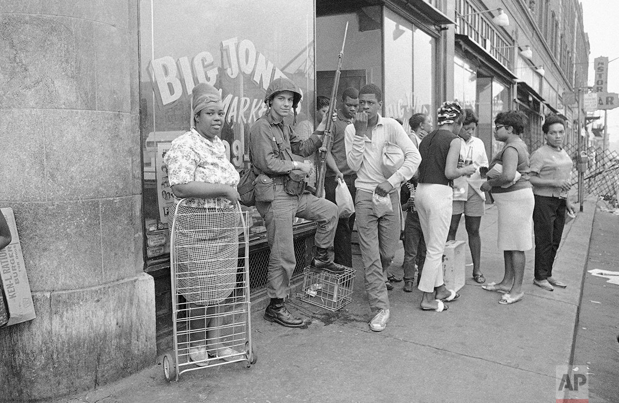 Michigan National Guardsmen relax for the first time since last Sunday when they were brought into Detroit to help put down widespread rioting, July 27, 1967. It was calm in the area on Wednesday night and after four days of violence that swelled into one of the costliest riots in the nation's history. (AP Photo)