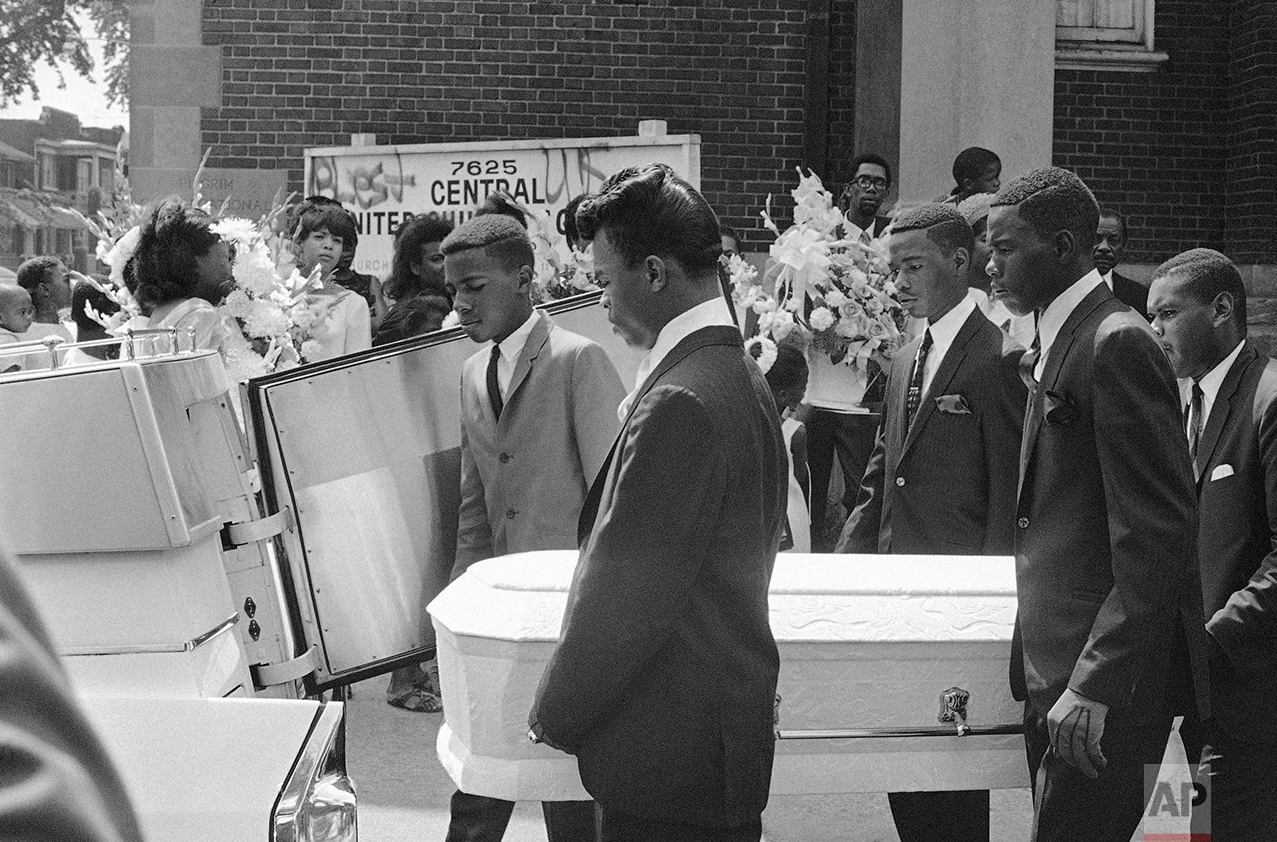 Pallbearers carry the tiny casket of Tanya Blanding, 4, a victim of riots in Detroit, Tuesday, August 1, 1967. The girl was killed as a hail of police and National Guard bullets swept an apartment building where she huddled on the floor. Officials said the flare of a match used to light a cigarette was mistaken for the flash of a sniper's gun. (AP Photo)