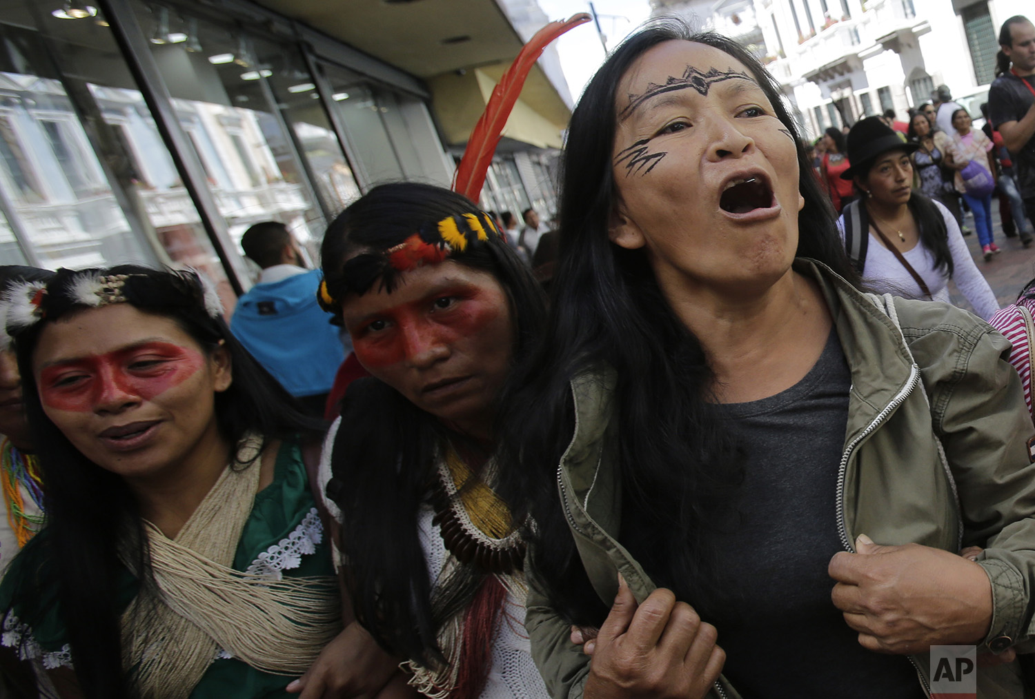 Indigenous leaders from across Ecuador march to the government palace to meet with President Lenin Moreno in Quito, Ecuador, Tuesday, July 4, 2017. (AP Photo/Dolores Ochoa)