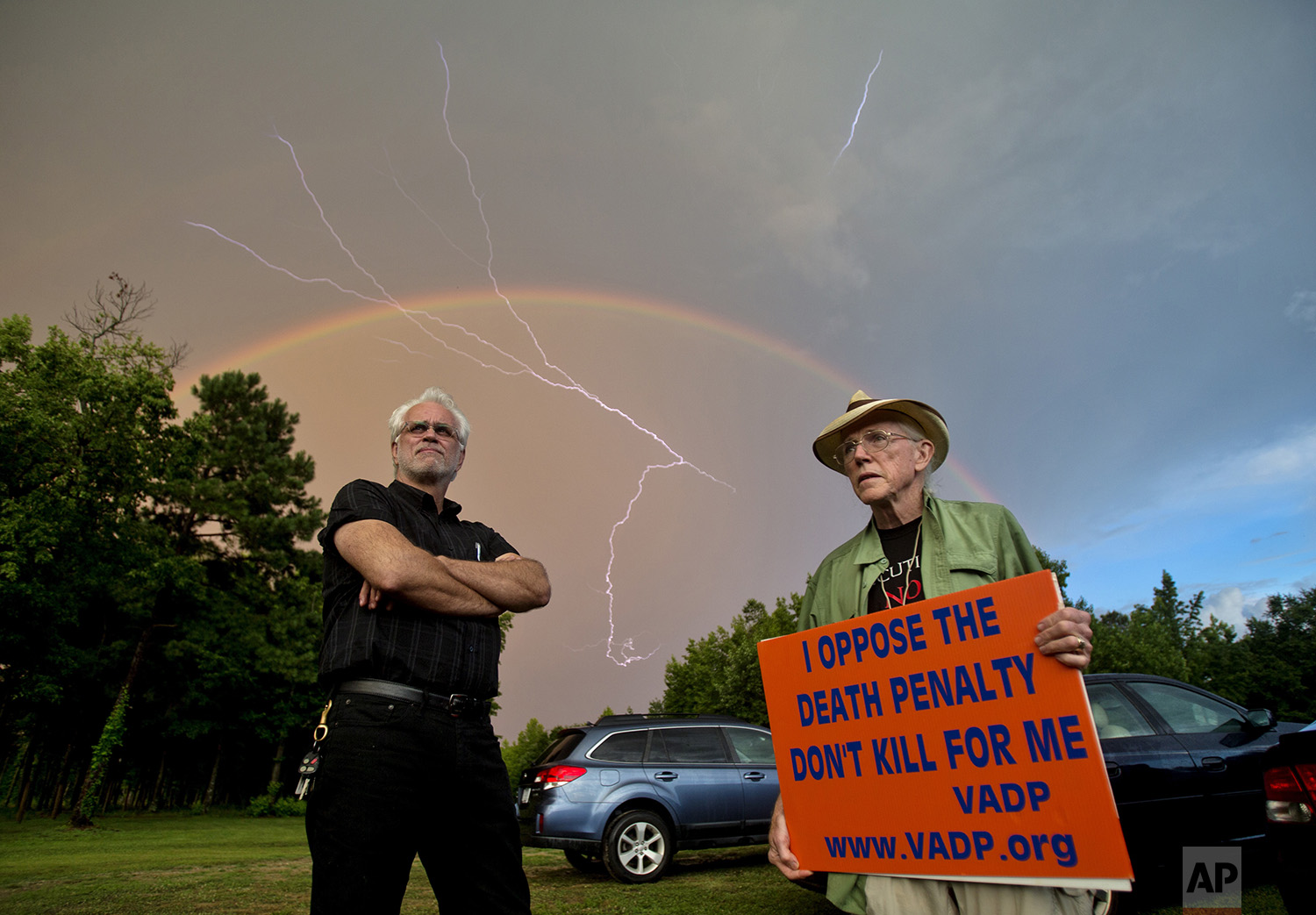 Dale Brumfield, of Doswell, Va., left, stands with Jack Payden-Travers, of Lynchburg, Va., on the day of the execution of William Morva in Jarrett, Va., Thursday, July 6, 2017. (Shaban Athuman/Richmond Times-Dispatch via AP)