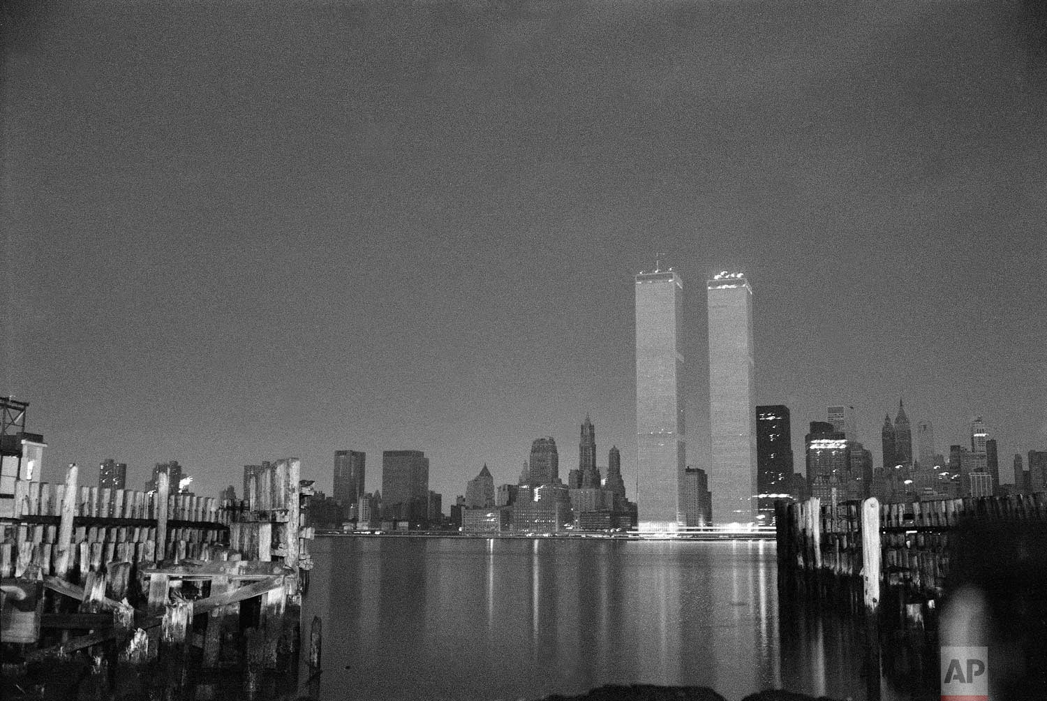 The World Trade Center stands out against a blackened New York City skyline after a power failure struck the city, July 14, 1977. Lightning striking a power station is blamed for the blackout.  (AP Photo/Lennox McLendon)