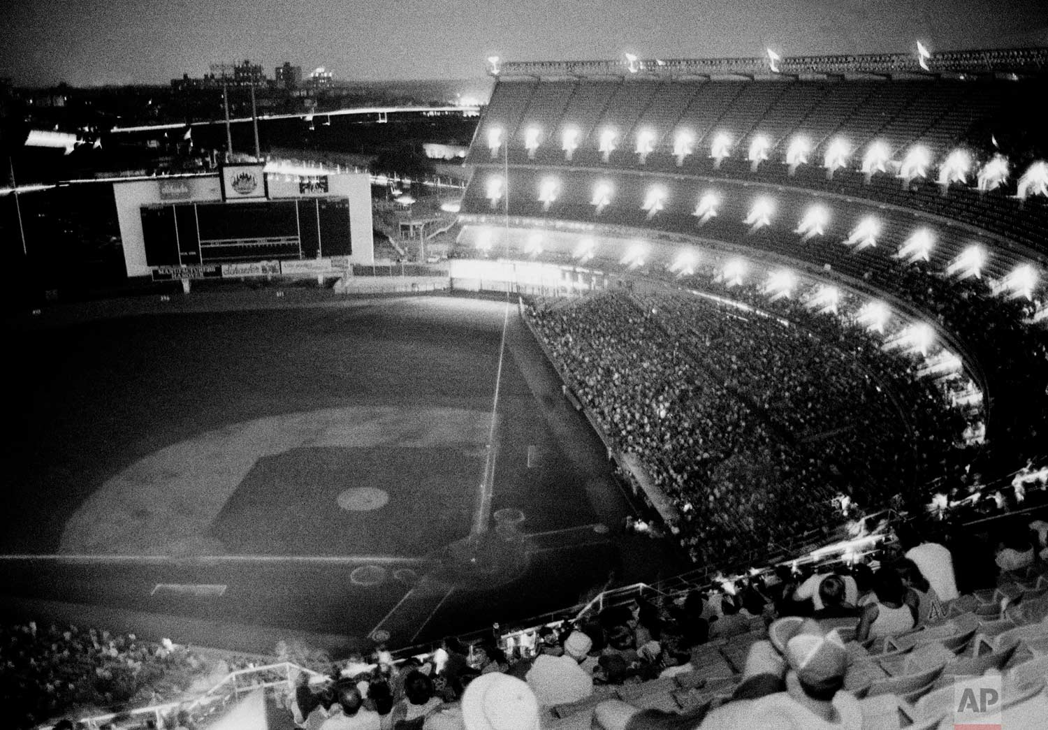 New York's Shea Stadium lies in darkness during the bottom of the sixth inning after the lights went out during the game with the Chicago Cubs, July 13, 1977.  The Mets were not the only ones blacked out as it appeared the power failure affected most of New York City. (AP Photo/Ray Stubblebine)