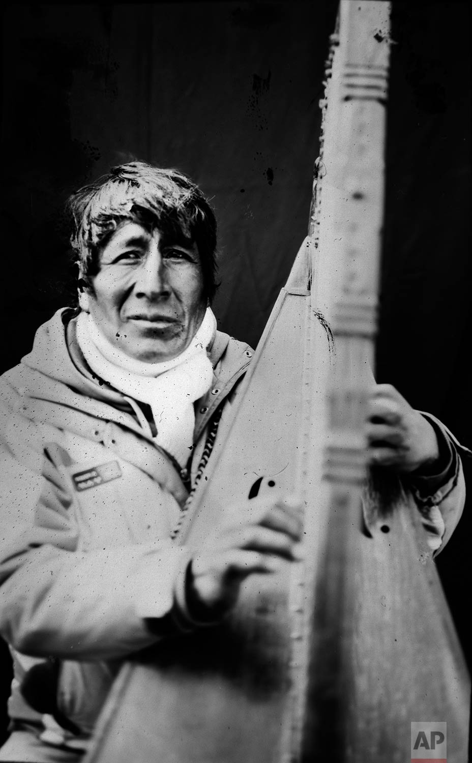 In this June 12, 2017 photo, contract musician Eulogio Quispe Chalco, 54, poses for a portrait with his Peruvian harp, in the Sinakara Valley, in Peru's Cusco region, during the Qoyllur Rit'i festival, translated from the Quechua language as Snow Star. The Peruvian variation of the harp has no peddles. (AP Photo/Rodrigo Abd)